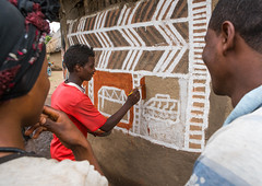 Young man painting the wall of a traditional ethiopian house, Kembata, Alaba Kuito, Ethiopia (Eric Lafforgue) Tags: abyssinia adolescent adultsonly africa african alaba architecture art artist building color culture day decorated decoration depiction eastafrica ethiopia ethiopian ethnic geometric home horizontal hornofafrica house housing hut illustration kulito man mural naive outdoors painted painter painting people poverty skill teenager threepeople toukoul tukul village woman women work working ethio163438 alabakuito kembata