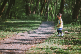 Side view of baby boy walking on footpath in forest, Shanghai