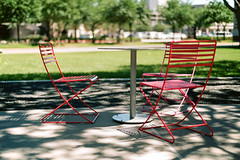 16940016 (alexdotbarber) Tags: 35mm houston houstongalleria kodakportra160 nikon50mmf14afd nikonf100 slr analog autofocus bokeh chairs colornegative film light meta35 shadow table