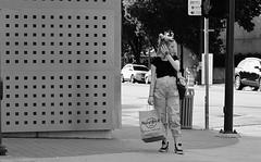 Har Rocker (burnt dirt) Tags: houston texas downtown city town mainstreet street sidewalk corner crosswalk streetphotography fujifilm xt1 bw blackandwhite girl man woman people person couple pair group crowd walking talking standing looking boots heels stilettos sandals model photographer camera lens dress skirt shorts glasses sunglasses purse bag phone cellphone pose longhair shorthair ponytail kneehigh blonde brunette headphones cap hat asian friends bike bicycle prom lovers