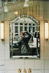 Minolta Greetings (Thomas Listl) Tags: thomaslistl color minolta x700 selfie mirror kodak ektar100 lamps reflection upright portrait window glass 50mm