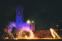 Tell me a story (Marta Marcato) Tags: colours colors outside history castle tower fire light play playing medieval medievale italy italia veneto night show fantastic story discover