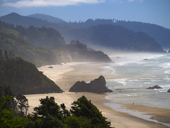 Misty Summer Day on the Oregon Coast (RobertCross1 (off and on)) Tags: 40150mmf456mzuiko clatsop em5 omd or olympus oregon oregoncoast pacificocean pacificnorthwest tillamook beach bluesky clouds coast coastline fog forest landscape mist sand seascape shore surf trees water waves