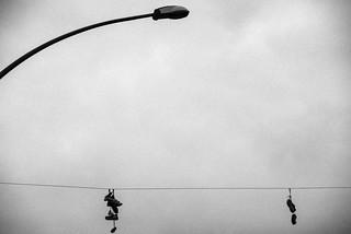 the desert sky / empty shoes, dark lamp, still life