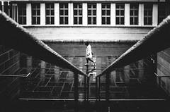 lost in the echo (matthias hämmerly) Tags: switzerland candid street streetphotography shadow contrast grain ricoh gr black white bw monochrom monochrome city town urban blackandwhite strasse people man monochromphotography dark zürich zuerich rain lonely swiss