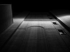 upward (John Drossos) Tags: monochrome blackwhite blackandwhite building contrast shadows architecture night nightshot nightphotography low key sky skyarchitecture