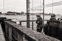 waiting for the ferry (Gerard Koopen) Tags: nederland netherlands amsterdam city capital bw blackandwhite blackandwhiteonly straat street straatfotografie streetphotography ferry waiting woman cold fujifilm fuji x100t 2017 gerardkoopen