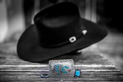 Inner Cowboy On Display (jah32) Tags: hat cowboyhat black blackcowboyhat jewelry navajojewelry beltbuckle buckle ring rings turquoise selectivecolour selectivefocus bokeh innercowboy