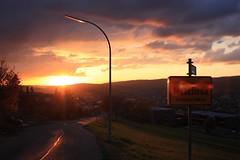 Sunset mood (_dankhn) Tags: meschede sauerland sunset sonnenuntergang sun sonne backlight hochsauerland germany deutschland gegenlicht sunbeams lensflare atmosphere mood evening street sign nrw nordrheinwestfalen northrhinewestphalia sky clouds light wolken