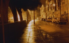 on nights like these (m_travels) Tags: night rain street alley dark longexposure konorotwild400cn 35mmfilm filmphotography experimental analogue motionpicturefilm sanfrancisco sf