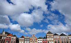 the sky over delft (delft, netherlands) (bloodybee) Tags: 365project delft netherlands holland europe street house building architecture window roof sky clouds skyline blue white