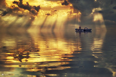 Fishing for rays... (Explored) (Kerriemeister) Tags: rays raysofgod raysoflight sky clouds cloud cloudscape reflection ripples water boat fishing magical digital art imagination photomanipulation photoshop composite composition