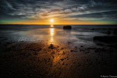 The sun is approaching the shore (martintimmann) Tags: loxia2821 sky romance sunrise longexposure sea portugal zeiss