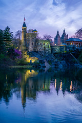 Magic castle (^Baobab^) Tags: nyc nycnight nycsunset newyorkcity newyork newyorkstate centralpark turtlepond lake water reflection belvederecastle manhattan park sunset clouds nature springs