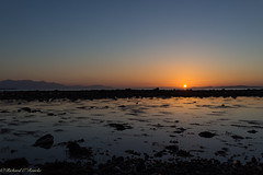 Ayrshire sunset (Rourkeor) Tags: ardrossan scotland unitedkingdom gb sunset reflections water sea hills glow horizon orange sony sonyrx1r rx1r fullframe carlzeiss zeiss sonnar t 35mm