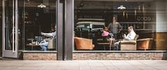 Looking in looking out (phil anker) Tags: people street window salisbury fujix70 photingo