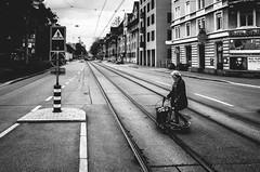 limmat street blues (matthias hämmerly) Tags: switzerland candid street streetphotography shadow contrast grain ricoh gr black white bw monochrom monochrome city town urban blackandwhite strasse people man monochromphotography dark zürich zuerich rain lonely swiss