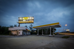 Abandoned Gas Station (Notley) Tags: sky clouds cloudysky evening bluehour thebluehour missouri notley notleyhawkins 10thavenue gasstation petrol gas petrolstation httpwwwnotleyhawkinscom missouriphotography notleyhawkinsphotography 2017 longexposure lighttrails abandoned billboard may dusk columbiamissouri businessloop sign