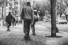 Gliding The Gangway (Ian Sane) Tags: ian sane images glidingthegangway skaters skateboarding moving skating black white candid street photography sidewalk surfing downtown portland oregon guys canon eos 5d mark ii two camera ef70200mm f28l is usm lens