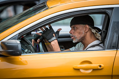 Street Credibility (tommiaarnio) Tags: new york city nyc usa us north america american taxi big cab yellow canary driver steering wheel color bandana cap landscape orienation ghetto street cred credibility medallion window open tommi aarnio tommy aarnyo