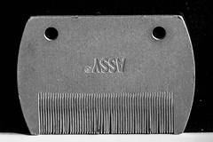 The sardonic smile of the ominous comb (Mario Donati) Tags: pareidolia macromondays nikon d3100 sigma70300mm bw 7dwf
