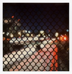 Chain Link Trails 2 (tobysx70) Tags: the impossible project tip polaroid sx70sonar sonar instant color film for sx70 type cameras impossaroid chain link trails 101 hollywood freeway los angeles street bridge dtla downtown la california ca fence night nocturnal headlight taillight trail red white bokeh us101 el camino real vanishing point toby hancock photography