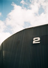 2 (OhDark30) Tags: agat 18 film 35mm halfframe 18x24 kodak 200 colorplus 2 industrial unit corrugated sky blue clouds