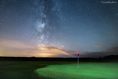 The 18th Hole - Milky Way, Dunstanburgh Golf Course, Embleton, Northumberland (Gary Woodburn) Tags: embleton golf course northumberland milky way stars starry night sky airglow clear calm flag hole putting green dunstanburgh