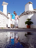 Tani and Nico (roomman) Tags: 2017 italy puglia apulien alberobello nico tani portrait reflect reflection mirror water puddle house trulli salent salento
