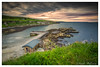 Portmuck Harbour (Deek Wilson) Tags: portmuck larne northernirelandlandscape seascape sunset clouds grass green sea longexposure rocks beach pier countyantrim canon7dmkii sigma 1020 lee big stopper filters