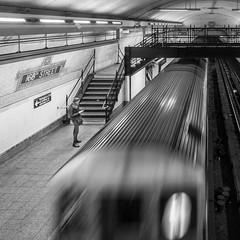 168th Street (John St John Photography) Tags: subway 1train 168thstreet subwaystation mta newyorkcity newyork streetphotography candidphotography slowshutterspeed moving train youngwoman passengers bw blackandwhite blackwhite blackwhitephotos johnstjohn