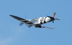 A Spitfire flypast (Halliwell_Michael ## Offline mostlyl ##) Tags: brighouse westyorkshire brighouse1940swe brighouse1940sweekend nikond40x 2017 aircraft airplane spitfire blue battleofbritainmemorialflight