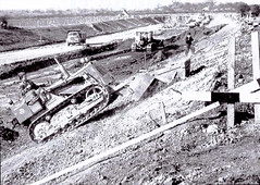 Shaping the Doncaster Bypass 1959. (ManOfYorkshire) Tags: tractors shovels diggers lorry lorries tractor shovel bulldozer 1959 construction doncaster bypass a1 a1m shaping sides embankments yorkshire southyorkshiore history motoring route routes arterial main gb designed
