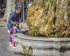 Child Discovering Hot Water at La Fontaine d'Eau Chaude