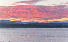Pink Cloud Sunset Seascape (Merrillie) Tags: landscape sunset nature australia mountains newsouthwales sea sun batemansbay scenery southcoast pink coastal layers clouds seascape nsw coast waterscape water