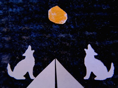 On the Side of the Road (Coyoty) Tags: flickrfriday onthesideoftheroad macro macromondays silhouette paper cutout moon orange white blue coyotes howling road techniques punched fabric craft fibers texture challenge color diagonal edge surreal symmetry asymmetry abstract close closeup contrast triangle angles