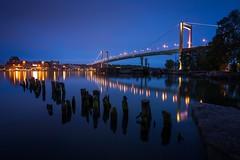 Älvsborgs Bridge (Arvid Björkqvist) Tags: bridge blue bluehour lights coast gothenburg sweden city poles moss reflections water canal evening dark calm still