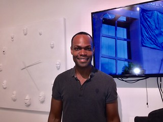 Artist Courtney Eugene Brown with his artwork at Kroma Studios in Coconut Grove
