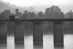 Truck Crossing (peterkelly) Tags: digital bw india asia canon 6d khajuraho bridge water river truck crossing forest railing trees