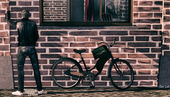 A big sigh of relief.... (Jos Loll) Tags: pee bike wall