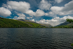 Mountainlake4 (Мaistora) Tags: scape landsape skyscape skyline lake lakescape water ripples reflections blue green white sky clouds hills mountains forest trees nature outdoor outdoors snowdonia northwales llanberys britain wales uk sony alpha ilce a6000 sel1018oss 1018mm f4 wideangle zoom ultrawide fisheye dxo optics detail iq quality lightroom touchup contrast colour color colourful painterly llanberis