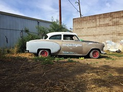 Chameleon (misterbigidea) Tags: classic vintage chevy chevrolet car auto hidinginplainsight urban city scenic landscape building matching colors evening beauty neighborhood hotwheels redrims backyard camouflage hidden project twotone summer