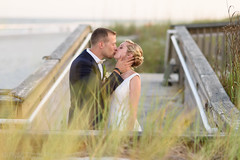 Kiss behind the sea oats - Grande Dunes Ocean Club (Ryan Smith Photography) Tags: wedding weddingphotography myrtlebeach httpswwwryansmithphotographycom
