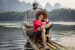 Relaxation (lycheng99) Tags: relax fisherman fishing cormorant cormorantfisherman cormorantfishing liriver líjiāng river karst karstformation bambooraft bamboo raft mountains guilin guangxi xingping china chinatravel