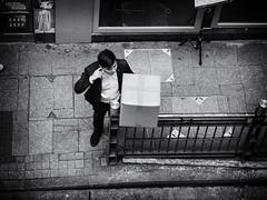 Man with Box and Finger in Ear (Feldore) Tags: hong kong street candid man cardboard box hongkong feldore mchugh em1 olympus