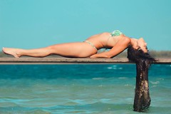Tourist 2 (A.Victória) Tags: beach sun warmtones blue lagoon woman relax heat jericoacoara vemprajeri canon rebel 600d zoom
