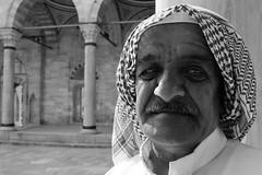 Syrian man (K.BERKİN) Tags: syrianman street streetphotograpy syrian refugee blackwhite white istanbul turkey mosque leica