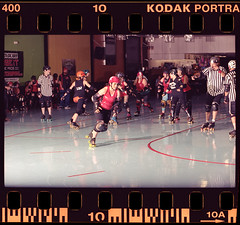 RRG vs MAD Bout 6.10 (daverollans) Tags: resurrectionrollergirls calskate rohnertpark northbayrollerderby rollerderby 35mmfilm canoneos35mm shootfilm staybrokeshootfilm thinkmoreshootless homeprocessedfilm c41process kodakportra400 cinestill cinestill800t canon100mmf2 evolv200 flashpoint strobist actionsports actionsportsphotography sonomacounty