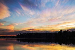 Colourful Cloud Smudges (Matt Molloy) Tags: mattmolloy timelapse photography timestack photostack movement motion colourful sky sunset clouds trails smudges lines trees water reflection littlecranberrylake haskinspoint seeleysbay ontario canada landscape nature lovelife