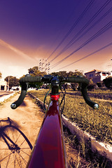 My Ride, my Joy (Ederson Gomes) Tags: wideangle grandeangular livre sunset sãocaetanodosul photoshop canon drama byke canon1022mm roadcycle cleanenergy brasil cores magenta brazil colorido colors bicicleta pordosol sp cycling red